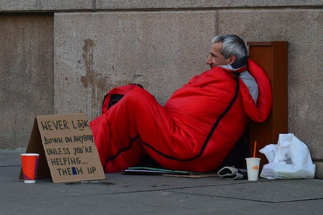 Homeless man with blanket